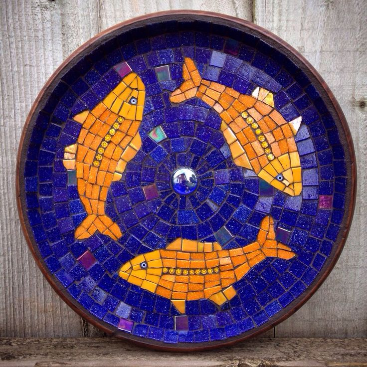 Glass fishy mosaic in a shallow up cycled wooden bowl from