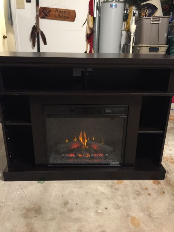 Used Pretty Black Shelf With S Fireplace Can Be Used As A Tv Stand It S Electric Uses A Regular Outlet Had Two Shelves It Black Shelves Tv Stand Fireplace