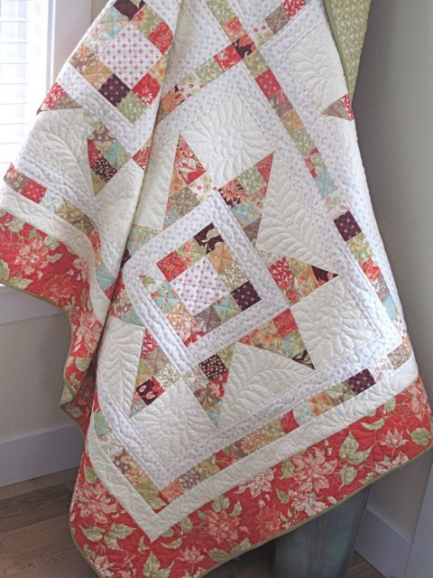 layer cake quilt | Love this Merry Quilt from the Sparkle Boughs of Holly blog