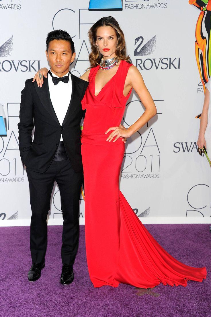 tall women posing with a shorter man