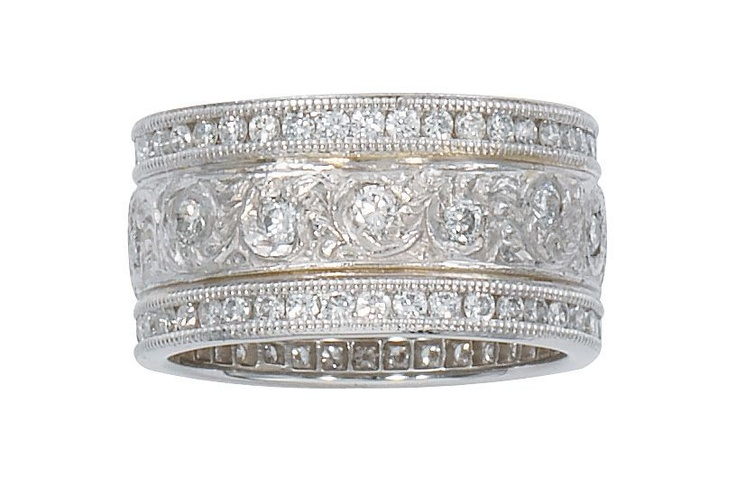 This vintage designed Armadani Platinum and Diamond Wide Wedding Band is carved with 1.50 ct  round brilliant diamonds that are channel set in a milgrain mounting. This special piece of bridal jewelry can be custom made with diamonds that are halfway around and is also available in 14 kt and 18 kt white, yellow and rose gold. This ring looks amazing worn separately! - See more at…