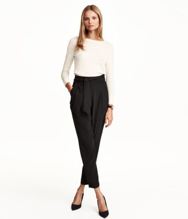 Black pants in woven fabric with a high waist, pleated front, and wide, tapered legs. Side pockets, one back pocket, and concealed side zip. Tie belt at waist. | H&M Modern Classics