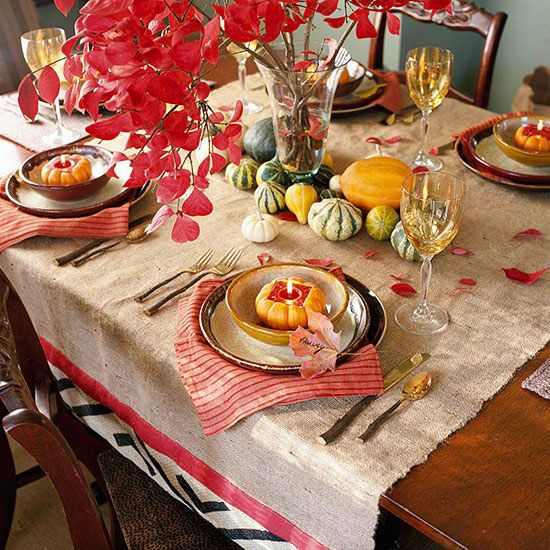 Burlap, graphic napkins and a gourd centerpiece makes for a festive fall table setting. More fall table settings:  http://www.bhg.com/thanksgiving/decorating/fall-table-settings/?socsrc=bhgpin101213tablesetting&page=10