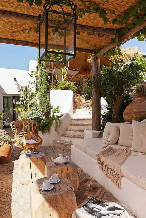 Outdoor living room, wood, trees, couch, blanket, chairs  Micoleys picks for #OutdoorLiving www.Micoley.com
