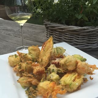 Fritti of courgette and nasturtium flowers; better than crisps . http://everydayfabulousfood.com/canapes-and-light-bites/crispy-courgette-flowers-aka-zucchini-fritti/  #tastysnacks #homegrown #summer #zucchinifritti  #edibleflowers