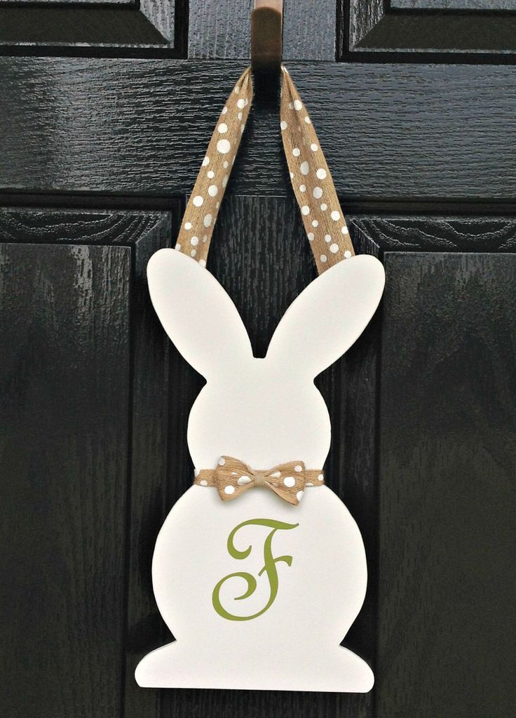 Easter Bunny Silhouette Wooden Door Hanger - with Monogram by AJsSouthernDesigns on Etsy https://www.etsy.com/listing/245991085/easter-bunny-silhouette-wooden-door