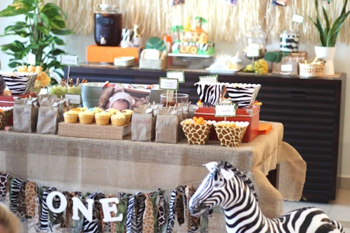 Main party table from Mod Jungle Safari Birthday Party at Kara's Party Ideas. See the whole jungle scene at karaspartyideas.com!
