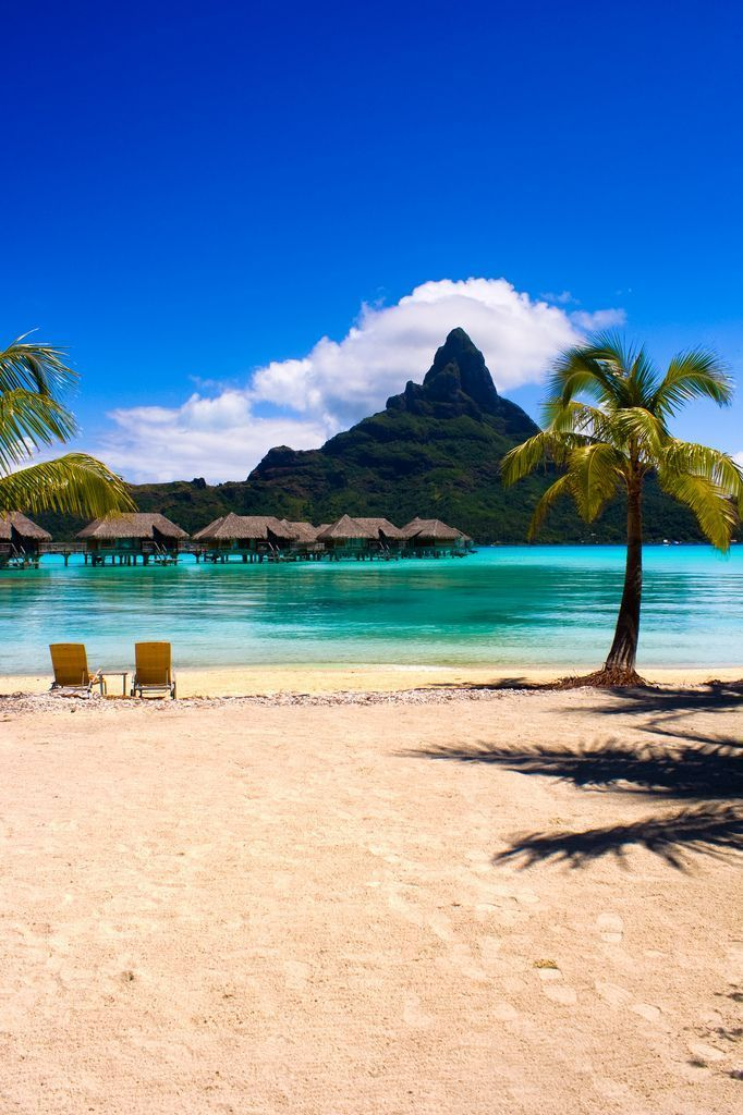 Bora Bora, French Polynesia | Vacation has a new cover photo. With views of the stunning Mount Pahia from the island's secluded sandy beaches, Bora Bora remains an enchanting Pacific paradise.