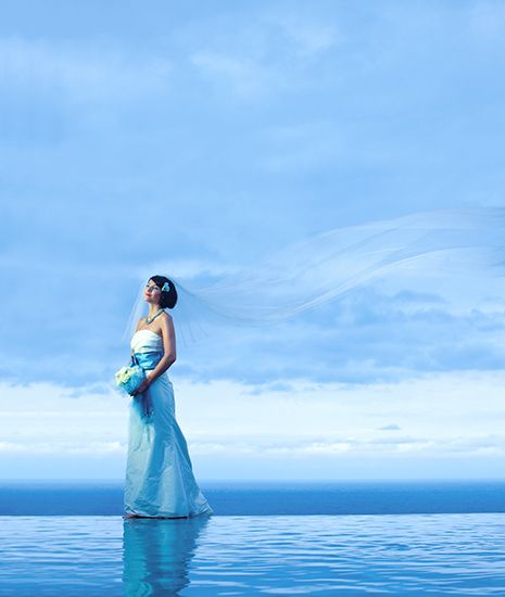 Bride at the edge of infinity pool by Tirtha Bridal Uluwatu Bali