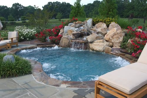 A large spa can double as a small swimming pool for Backyard inground pool designs