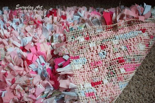 Craftaholics Anonymous® | How to Make a Rag Rug tutorial. The rug really was simple to make, just time-consuming. Basically, I used strips of fabric (1000s of them) cut about 1 inch x 5 inches. I stuffed these strips into a non-skid rug mat and voila! No need to even bother tying the strips. You can see the rug mat in this image and about how often I skipped holes.
