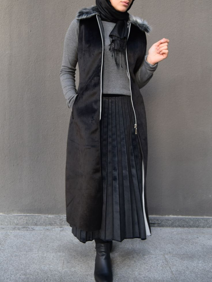 Too many layers for me personally but I like the long jacket vest she has on