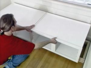 DIYNetwork.com demonstrates how to build a window seat using wall cabinets.