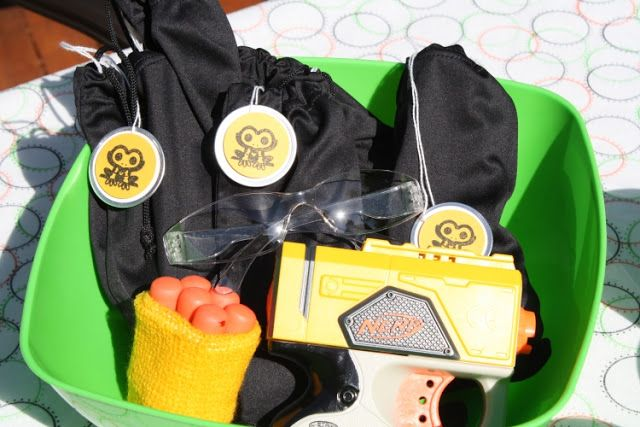 Goodie bags with sweat band ad a few darts, protective eye wear, a small nerf gun