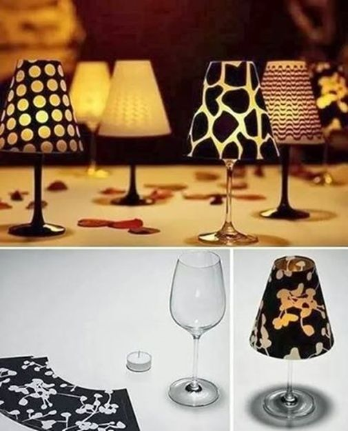 Inexpensive wine glasses ---> fancy candle lamps, just topped with vellum shade.