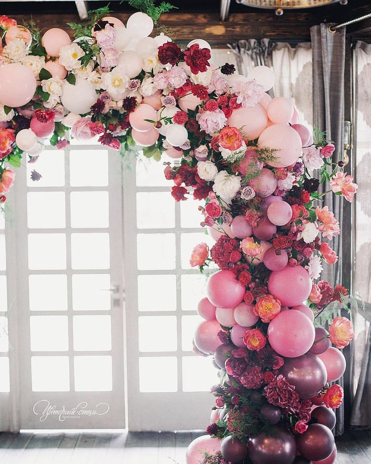 Balloon and floral wedding arch - what an interesting way to use balloons!