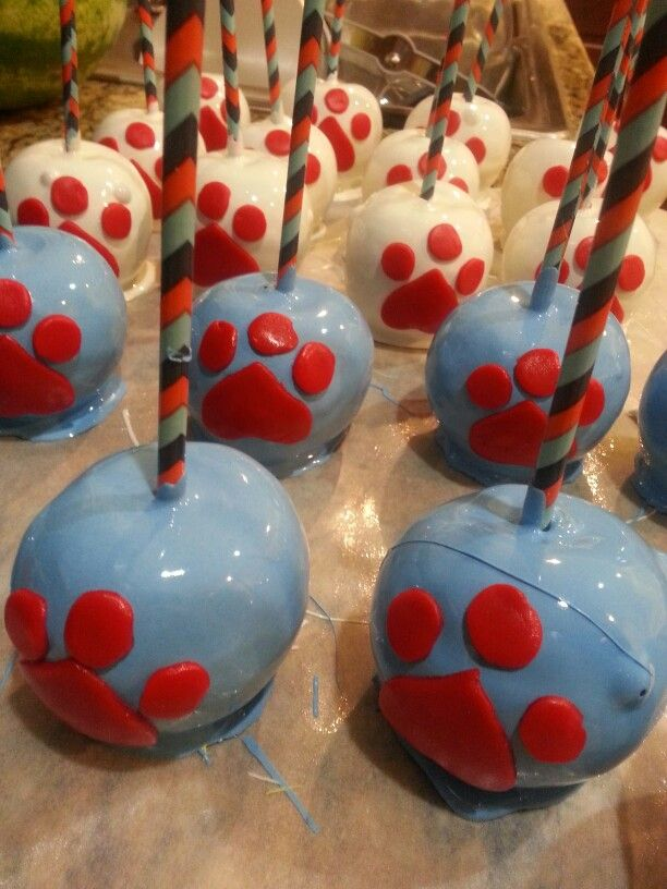 Blue and white candy apples, red paw prints