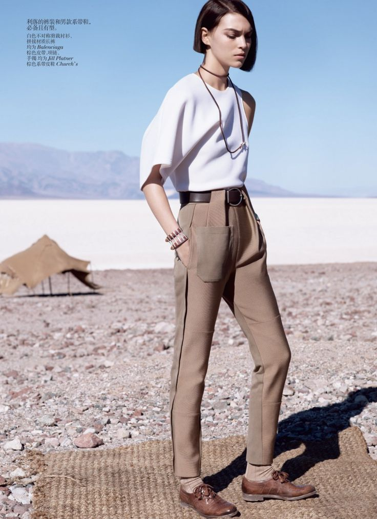 Deserted Luxury – Showing off that sharp dressing is a useful skill no matter where you go, photographer Josh Olins captures Arizona Muse in Vogue China's May cover shoot. Stylist Nicoletta Santoro chooses a selection of garments from labels such as Hermès, Michael Kors and Balenciaga with props by set designer Kadu Lennox (Frank Reps) used to shelter the beauty from the winds of Death Valley National Park. / Makeup by Maki Ryoke @ Tim Howard Management, Hair by Shon @ Julian Watson Agency