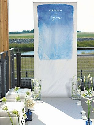 watercolor photo booth backdrop .. love this on the balcony which makes a great backdrop #reception #wedding