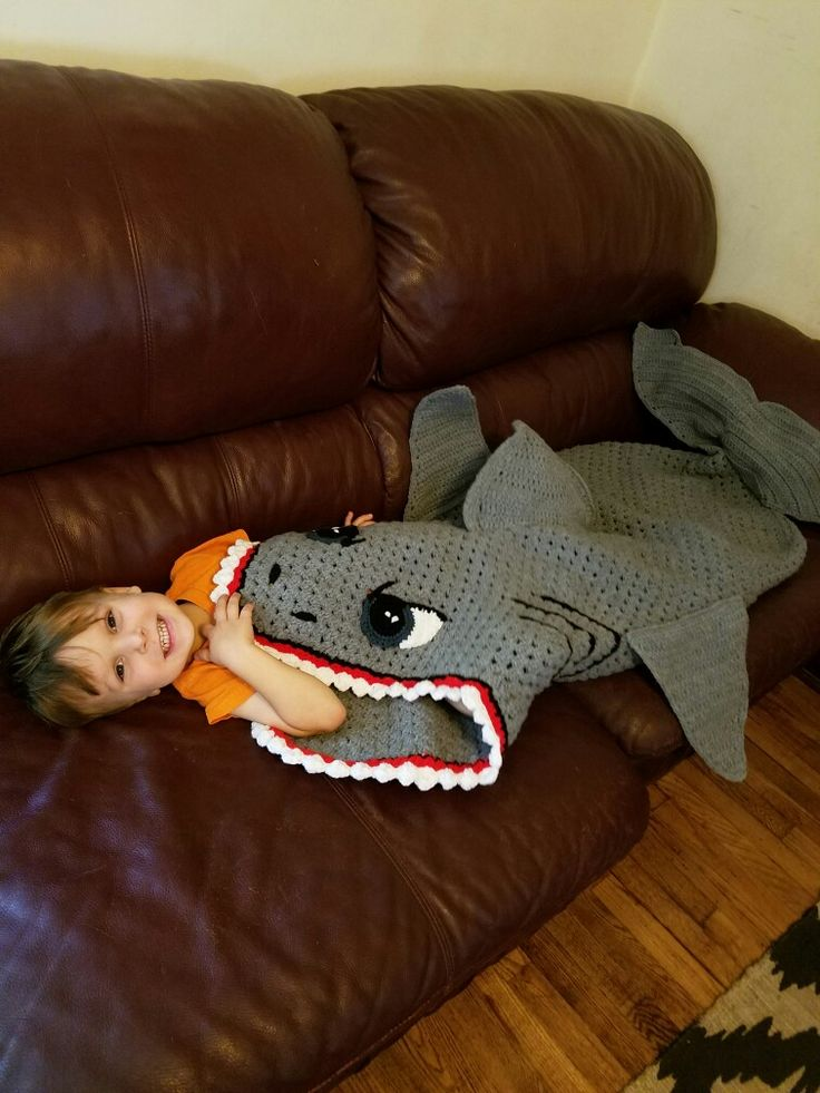 Crochet shark blanket - a similar pattern is available from Bernat and a paid pattern on Etsy here:https://www.etsy.com/listing/464463274/crochet-shark-sleep-sack-pattern?utm_source=Pinterest&utm_medium=PageTools&utm_campaign=Share There are a couple of other patterns that could be adapted. :)/LL