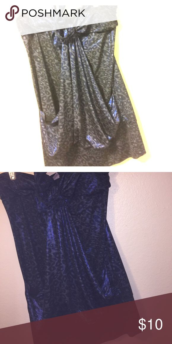 Blue cheetah print dress Cheetah printed dress with a slight glow of blue (kinda hard to explain hopefully the pictures help) strapless but has tie string for around the neck Taboo Dresses Strapless