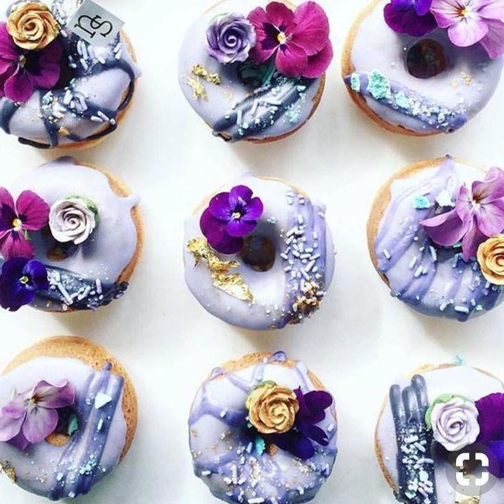 edible flowers on purple wedding cupcakes