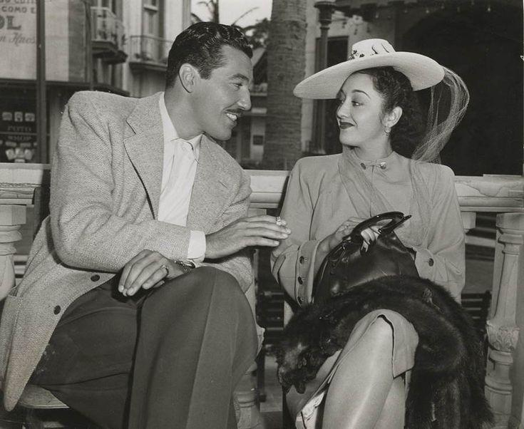 Half-Cuban actor César Romero (whose grandfather was famed Cuban poet and revolutionary José Martí) chats with Mexican actress Elena de la Cruz in Havana, 1946