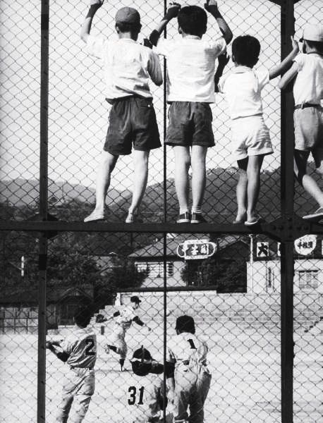 Children watching a baseball game through a fence, Kyoto 1961 by Eliot Elisofon