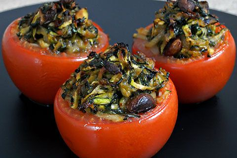 Moroccan stuffed tomatoes - a tomato stuffed with zucchini, onion, garlic, cilantro and pistachios, from cookbook author and food consultant Anissa Helou. New York Times.