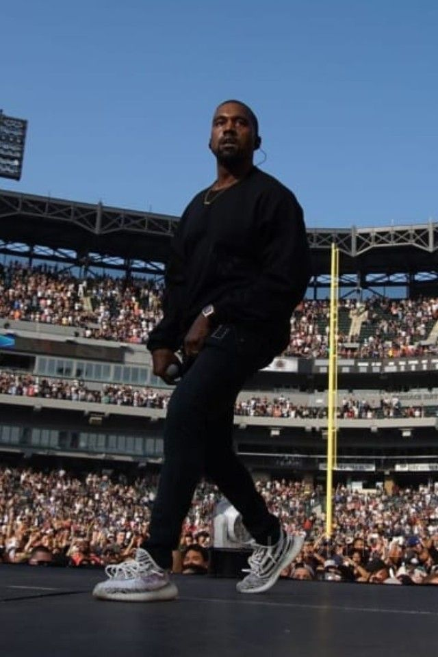 Kanye West wearing  Adidas Yeezy Boost 350 V2 Sneakers