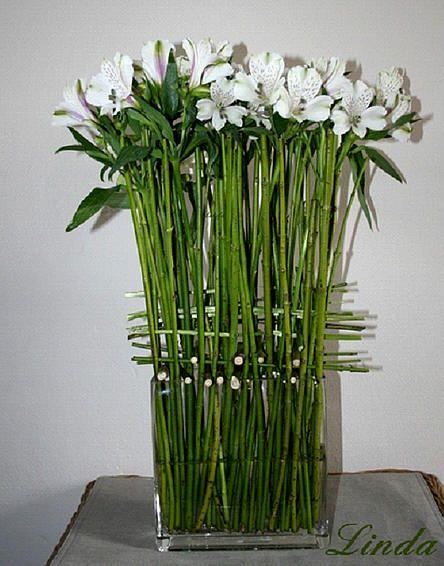 Online bloemschikken tussen takken - weven met takken - eenvoudig bloemschikken winter