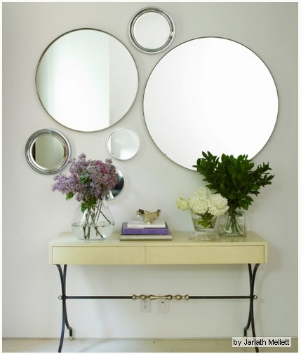Mirrors. (I could do something like this above the piano!)