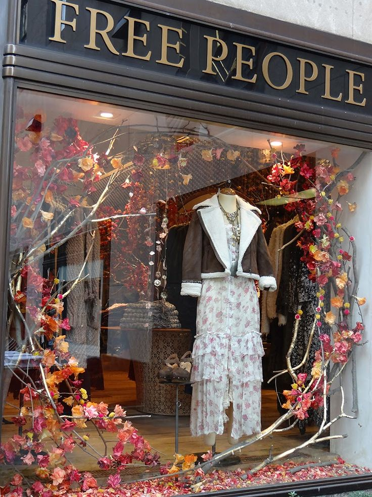 Beautiful Window Displays! Love the natural elements!