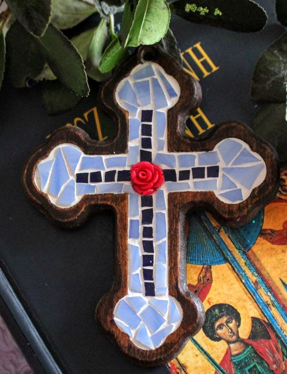 Mosaic cross with with two shades of blue and a red by Psifida
