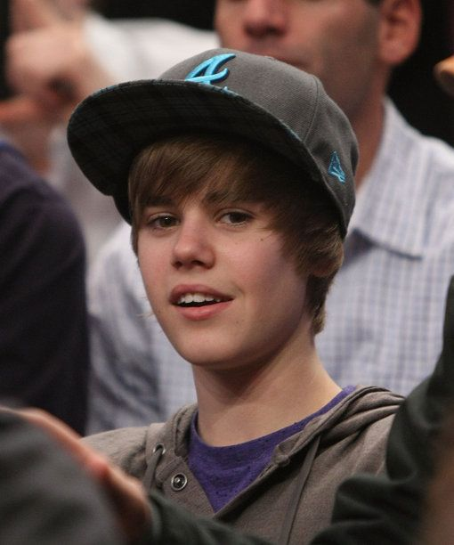 Singer Justin Bieber watches the game between the New York Knicks and the Portland Trail Blazers at Madison Square Garden on December 7, 2009 in New York, New York.