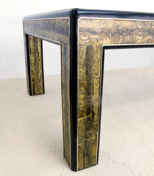 The acid etched brass on this Bernhard Rohne coffee table fits right in with the 70s psychedelic aesthetic and is even reminiscent of flowing Emilio Pucci shapes swirling on caftans.