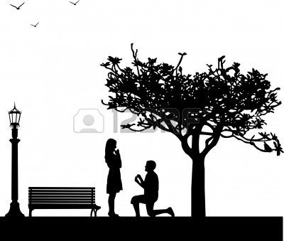 Romantic proposal in park under the tree on Valentine Stock Photo