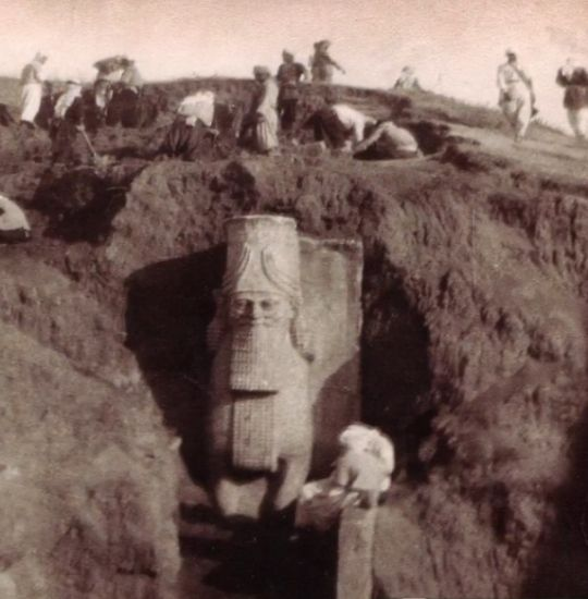 Recently Destroyed 7th Century BC Assyrian Statue, Photo c1850 Photo from the mid-9th c excavation of the colossal statues at the Nergal Gate of the ancient city of Nineveh. One of two winged bull-men (aka lamassu) that guarded one of the entrances to Nineveh dated to the time of King Sennacherib. Named for the Mesopotamian god Nergal, the gate was possibly used for ceremonial purposes since it is the only known gate flanked by sculptures of winged bull-men. Believed to be protective…