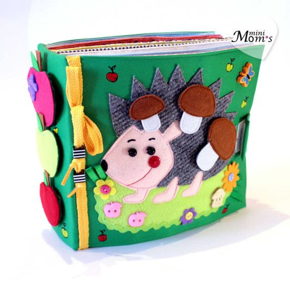 Quiet active book made of cloth is recommended for children from 1 year old. It consists of 7 sheets. On every of 12 pages there are different kinds of