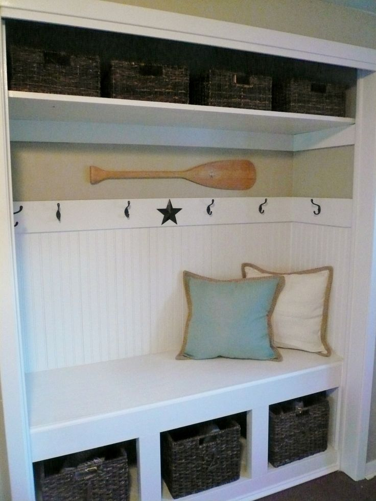 Closet turned into a bench with storage for shoes and hooks for coats and dog leashes!