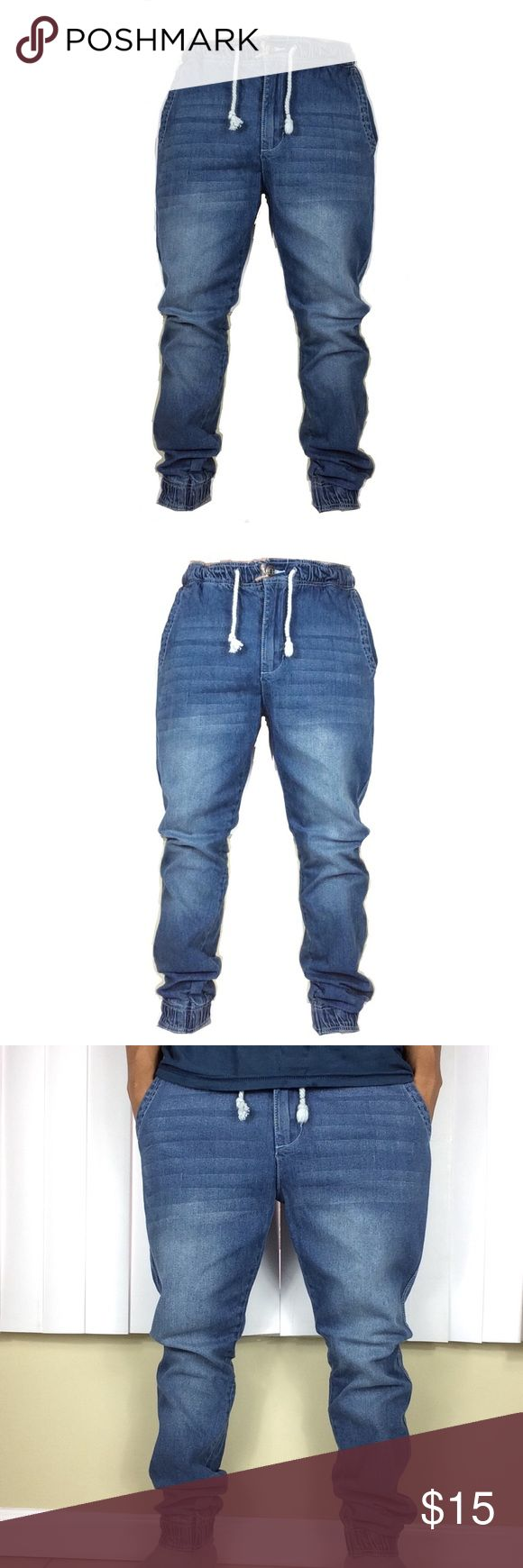 Mens stretch denim slim fit drawstring joggers nwt new with tags mens nwt Light wash denim Jean joggers Stretch denim Spandex waistband for better fit comfort Slim fitted  98% cotton 2% spandex Inseam 32 Fashionable 2 side pockets and one back pocket Features zipper fly Jeans Slim
