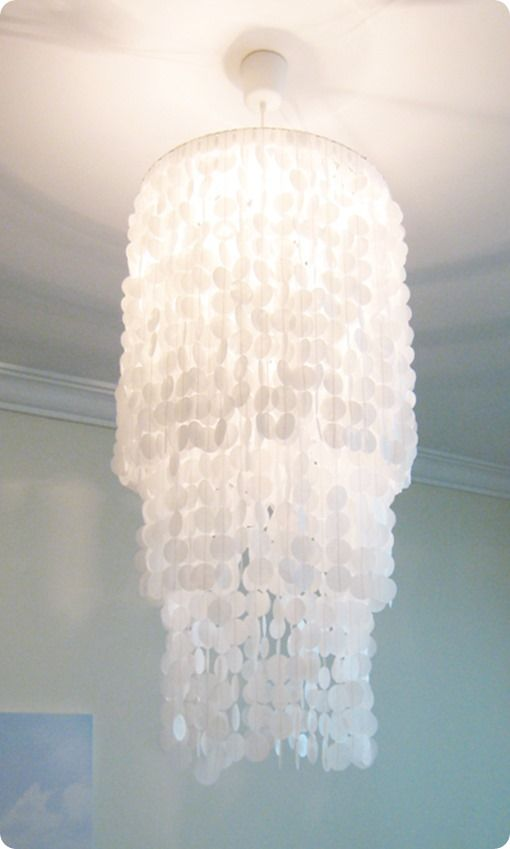 DIY Capiz Shell Chandelier ~ This amazing chandelier is made with wax paper and a circle punch!