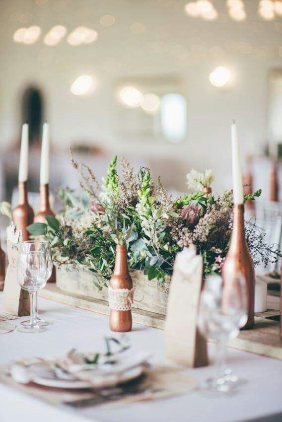 The cape fynbos goes so lovely with a rustic wedding theme. Combined with wood it really looks so raw but yet so romantic