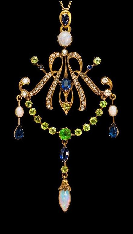 Art Nouveau pendant - Handcrafted in 14K yellow gold and set with 14 Russian Uralian green demantoids, 6 blue sapphires, 4 opals, 44 rose-cut diamonds, and 5 diamonds in various cuts.