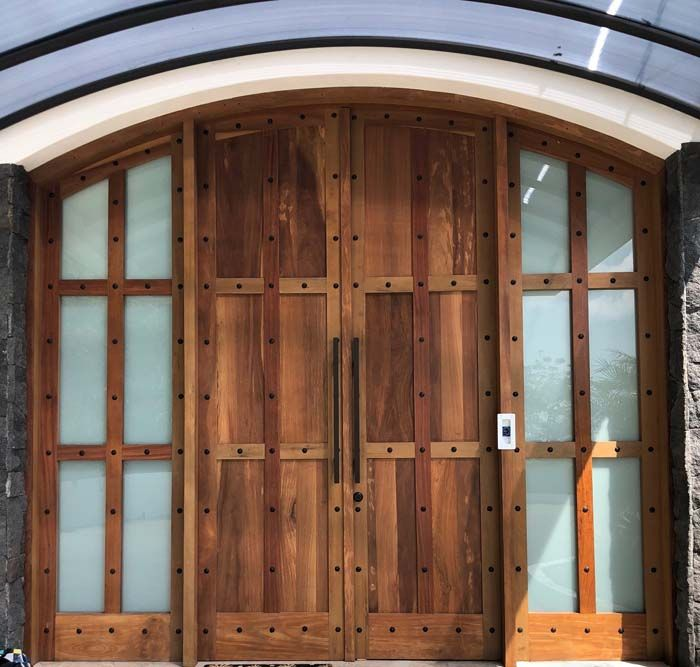 These 12 Foot Tall Cedar Doors Were 3 1 2 Inches Thick Entry Doors Door Pulls Contemporary Glass Doors