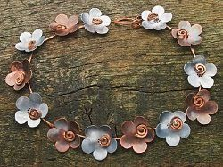 Learn to make this necklace in our free ebook! Alternative Metals: Free Guide and Projects for Making Bronze, Brass, and Copper Jewelry - Jewelry Making Daily