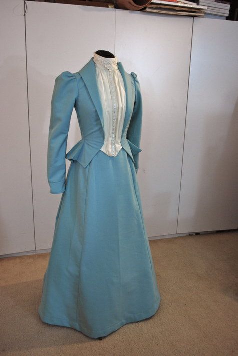A Victorian suit dress for a character in a Sherlock Holmes high school play. I used the Simplicity 4156 pattern. the pattern was originally a 1895 dress with the leg o' mutton sleeves, but I changed the sleeves to give it an earlier feel of about 1890.The blue fabric is a drapery fabric and I recycled the cream fabric from a man's button down shirt. The front closes with hooks and eyes and snaps at the collar. It also has about 10 pieces of boning throughout the top, sewn inside the lining.
