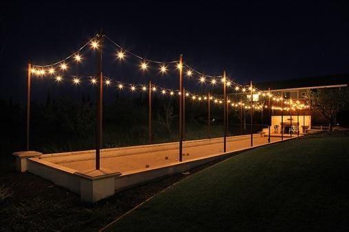 We can't get enough of this beautiful bocce court complete with gorgeous cafe lights! #want