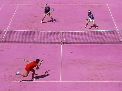 Iva Majoli and Conchita Martinez play against Anke Huber and Barbara Schett on a pink court marking Women''s Day at the French Open.