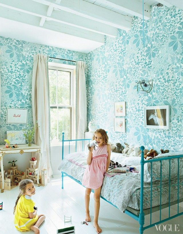 A children's bedroom with ivory floors and  hand-painted wallpaper